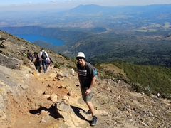 Robby on the hike down Santa Ana volcano with Lake Coatepeque visible in the distance