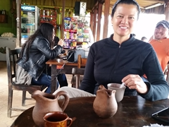 Grabbing breakfast while our friendly driver smiles in the background, shuttle from Copan to San Pedro Sula