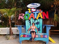 Sitting on a beach throne; West Bay