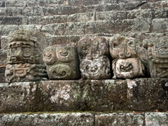 Carved heads; Jaguar Court section of Copan Ruins