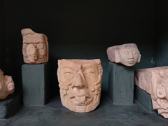 Carved faces; Copan Museum