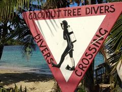 SCUBA divers crossing road sign; West End