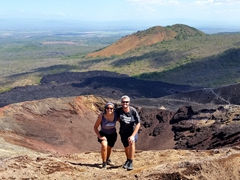 Taking a photo at the top of Cerro Negro