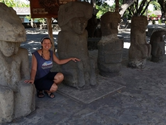 Becky posing with the petroglyphs at the old church of Altagracia