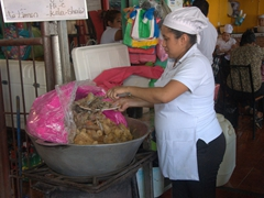 "Getting an order of baho (Nicaraguan beef, plantains and yuca) at ""Baho Vilma""; Masaya market"