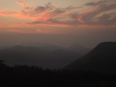 The sky is painted pink as the sun slowly rises; Telica volcano