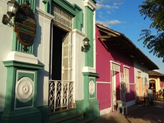 Colorful buildings line our favorite street in Granada, Calle La Calzada