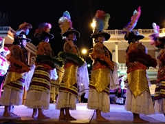 Dancers in traditional folk costume take the stage; Central Park in Granada