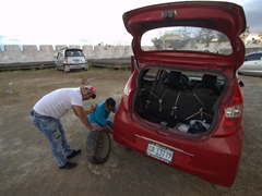 Having to fix a flat tire before zipping off to Masaya volcano for a view of the lava lake at night