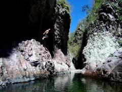Robby jumping into a natural pool; Somoto Canyon
