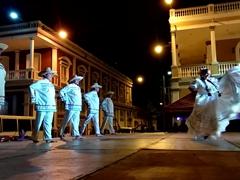 Folk dancers in traditional attire entertain the crowd; Granada