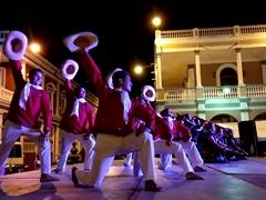 Dancers in costumes performing traditional folk dances