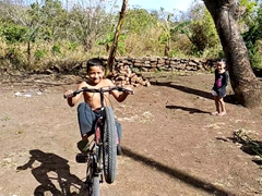 Cute kid showing off his riding skills
