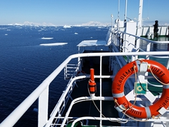 By lunch, we had spectacular weather again. Our red Akademik Ioffe life ring stands out against the blue backdrop