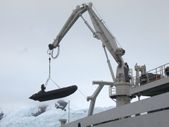 Winching a zodiac back on board the Akademik Ioffe