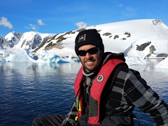 Robby enjoying the perfect weather conditions while cruising around Cuverville Island