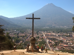 Tourists gather at the stone cross of Cerro de la Cruz for a fine view towards Volcán Agua