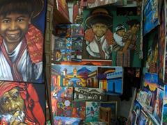Colorful artwork on display; Antigua artiisan market