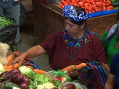 Buying carrots; Panajachel