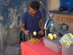 Making fresh orange juice; Panajachel