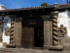 Lion stone carving at the entrance to La Casa De Don Rodrigo