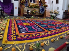 "During the month of Lent, every church displays an ""alfombra"" (carpet) made of colored sawdust, flowers, fruits and vegetables"