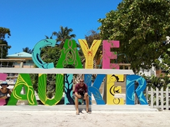 Taking a photo with the Caye Caulker sign