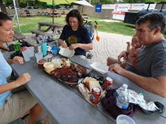 Enjoying our BBQ feast and Big Red soda with Andrea, Mike, Miles and Mason