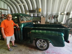 Joe Ochoa with his restored 1957 Chevy