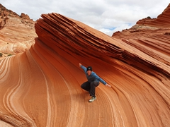 Robby surfing a wave; Coyote Buttes North