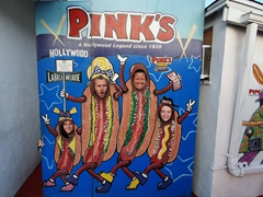 Posing at the Pink's hotdog sign