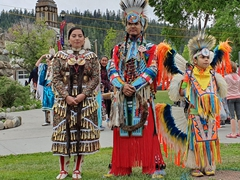 Aboriginal pow wow members pose for photos; Jasper