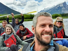Group canoe shot on Vermillion Lake; Banff
