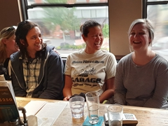 Laughing over beers at Banff Ave Brewing Co.