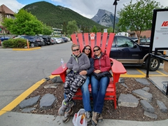 Squeezing onto a red chair; Banff