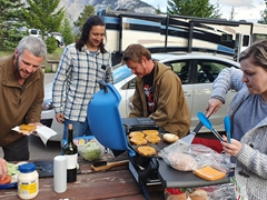 Ally and Lars prepare tasty burgers for dinner; Village 2 Campground