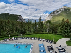 Swimming pool with a view of the Rockies; Fairmont Banff Springs
