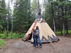 Alli and Luke smile outside their tipi; Sundance Lodges
