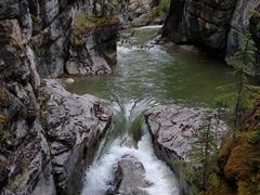 A gushing river flows through Maligne Canyon