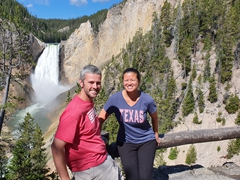 Posing in front of the lower Yellowstone Falls at Red Rock Point