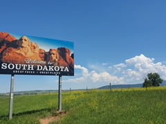 """Great faces, great places"" - Welcome to South Dakota sign"