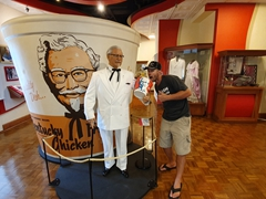 Robby taking a bite of chicken; Colonel Sanders Museum
