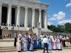 Mennonites preparing to sing in front of the Lincoln Memorial
