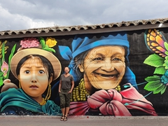 Becky next to street art in Otavalo
