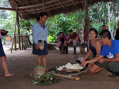 Showing us how to make chicha, the chew-and-spit alcoholic drink made from fermented yuca