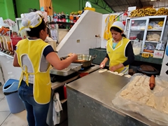 Tasty and cheap cheese empanadas for sale at the Banos market