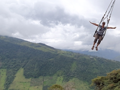 Swinging over the edge of a mountain at La Casa del Arbol; Banos