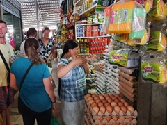 Cook group shopping at the Tena market