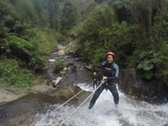 Becky getting ready to abseil down a waterfall