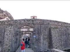 Panoramic view of Kotor's medieval walls, complete with a moat!